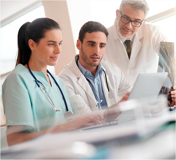 Doctors using computer